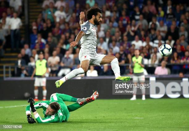 Mohamed Salah of Liverpool jumps over Wayne Hennessey of Crystal Palace during the Premier League match between Crystal Palace and Liverpool FC at...
