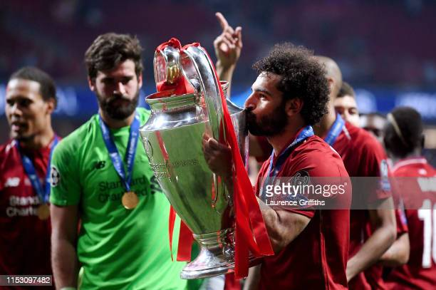Mohamed Salah of Liverpool kisses the Champions League Trophy after winning the UEFA Champions League Final between Tottenham Hotspur and Liverpool...