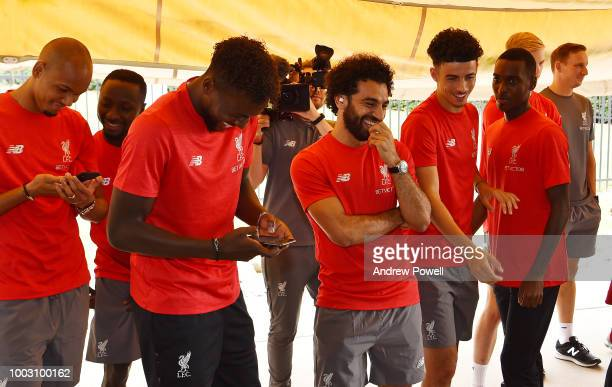 Mohamed Salah of Liverpool laughing as players change tyres during a tour of Roush Fenway Racing on July 21 2018 in Charlotte North Carolina