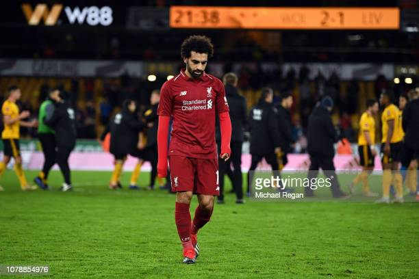 Mohamed Salah of Liverpool leaves the pitch after his side lost the Emirates FA Cup Third Round match between Wolverhampton Wanderers and Liverpool...