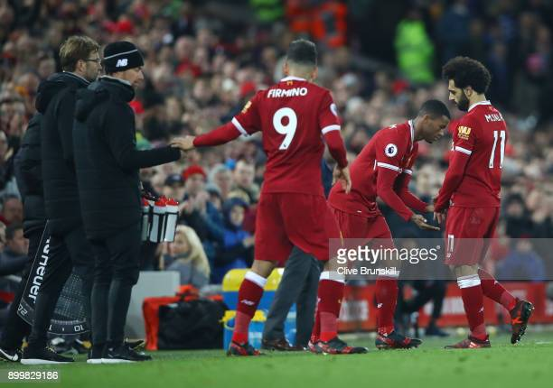 Mohamed Salah of Liverpool leaves the pitch to make way for Georginio Wijnaldum of Liverpool whom is substituted on during the Premier League match...