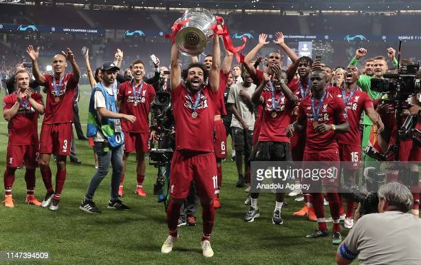 Mohamed Salah of Liverpool lifts the Champions League Trophy after winning the UEFA Champions League Final between Tottenham Hotspur and Liverpool at...