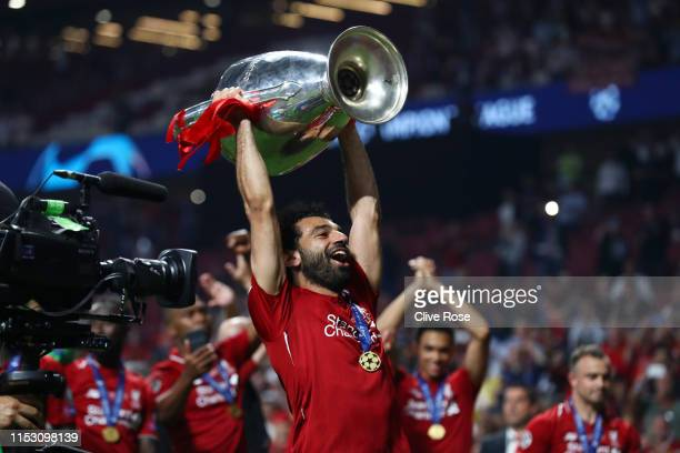 Mohamed Salah of Liverpool lifts the Champions League Trophy following the UEFA Champions League Final between Tottenham Hotspur and Liverpool at...