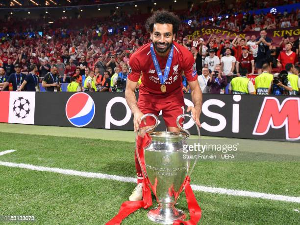 Mohamed Salah of Liverpool lifts the winners trophy after the UEFA Champions League Final between Tottenham Hotspur and Liverpool at Estadio Wanda...