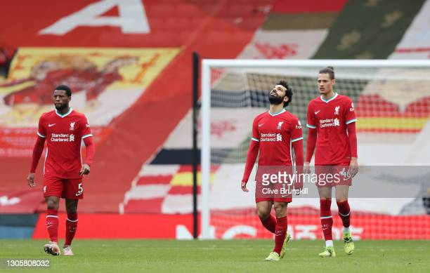 Mohamed Salah of Liverpool looks dejected with team mates Georginio Wijnaldum and Rhys Williams after Fulham's first goal scored by Mario Lemina...