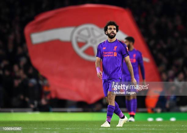 Mohamed Salah of Liverpool looks on after Alexandre Lacazette of Arsenal scores his sides first goal during the Premier League match between Arsenal...