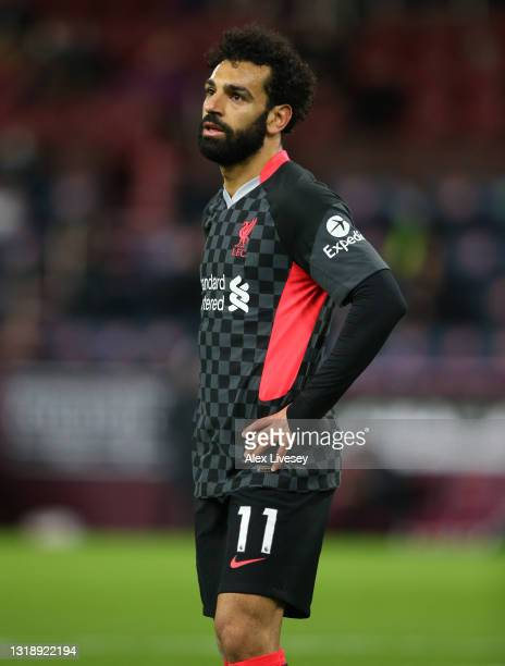 Mohamed Salah of Liverpool looks on during the Premier League match between Burnley and Liverpool at Turf Moor on May 19, 2021 in Burnley, England. A...
