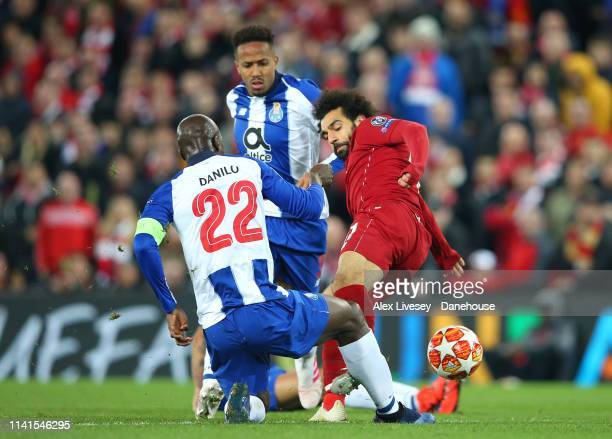 Mohamed Salah of Liverpool lunges in on Danilo of Porto during the UEFA Champions League Quarter Final first leg match between Liverpool and Porto at...