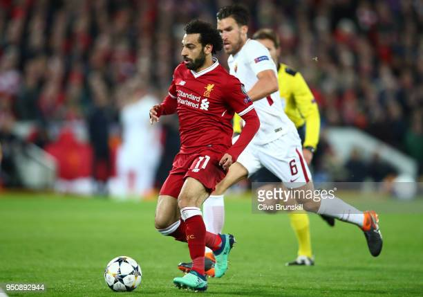 Mohamed Salah of Liverpool moves away from Kevin Strootman of AS Roma during the UEFA Champions League Semi Final First Leg match between Liverpool...
