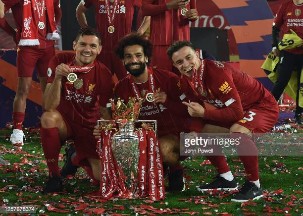 Mohamed Salah of Liverpool of Liverpool and Dejan Lovren of Liverpool and Xherdan Shaqiri of Liverpool with the Premier League Trophy match between...