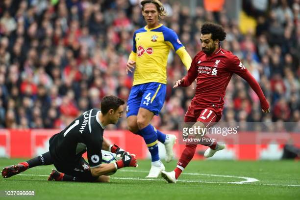 Mohamed Salah of Liverpool of Southampton with Alex Mcarthy during the Premier League match between Liverpool FC and Southampton FC at Anfield on...