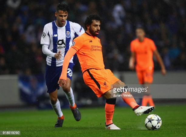 Mohamed Salah of Liverpool passes ahead of Diego Reyes of FC Porto during the UEFA Champions League Round of 16 First Leg match between FC Porto and...