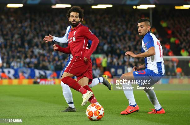 Mohamed Salah of Liverpool passes the ball past Jesus Corona of Porto during the UEFA Champions League Quarter Final first leg match between...