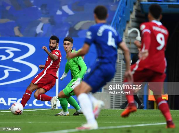 Mohamed Salah of Liverpool passing the ball past Kepa Arrizabalaga of Chelsea during the Premier League match between Chelsea and Liverpool at...