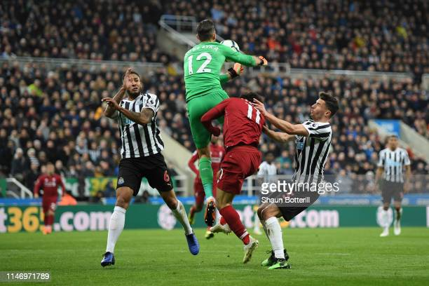 Mohamed Salah of Liverpool picks up an injury as he collides with Martin Dubravka of Newcastle United as they compete for the ball during the Premier...