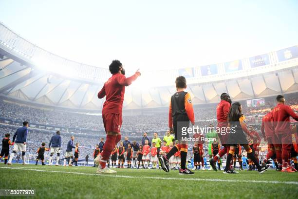 Mohamed Salah of Liverpool points to the sky as he walks out prior to the UEFA Champions League Final between Tottenham Hotspur and Liverpool at...