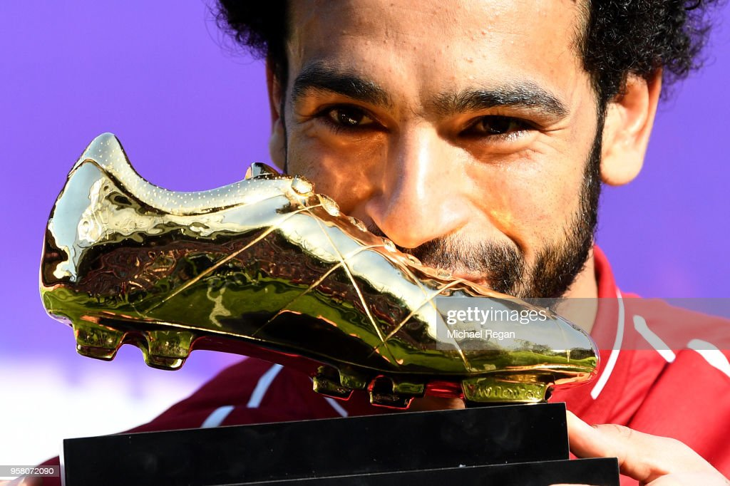 Mohamed Salah of Liverpool pose for a photo with his Premier League Golden Boot Award after the Premier League match between Liverpool and Brighton and Hove Albion at Anfield on May 13, 2018 in Liverpool, England.