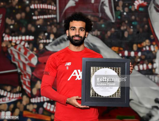 Mohamed Salah of Liverpool pose for a picture with his Ballon D'or Nominations at Melwood Training Ground on November 12 2019 in Liverpool England