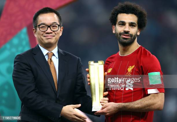 Mohamed Salah of Liverpool poses as he is presented with the Alibaba Cloud Player of the Tournament Award following his team's victory in the FIFA...
