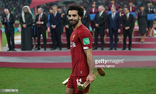 Mohamed Salah of Liverpool poses for a photo after he was named best player in the tournament during the cup ceremony at the end of the FIFA Club...
