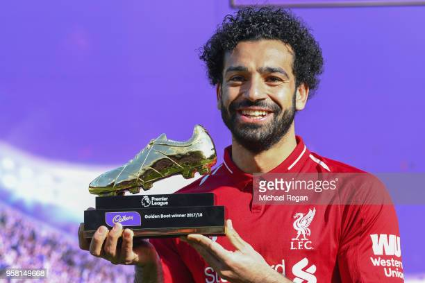 Mohamed Salah of Liverpool poses for a photo with his Premier League Golden Boot Award after the Premier League match between Liverpool and Brighton...