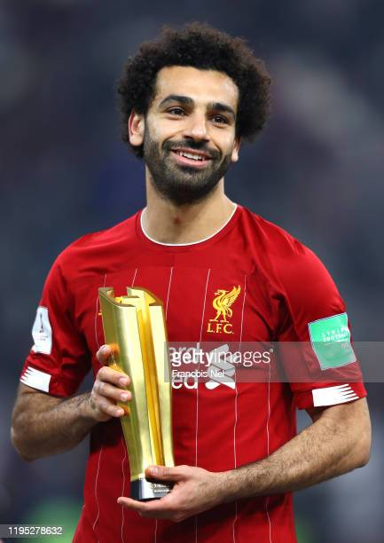 Mohamed Salah of Liverpool poses with the Alibaba Cloud Player of the Tournament Award following his team's victory in the FIFA Club World Cup Qatar...