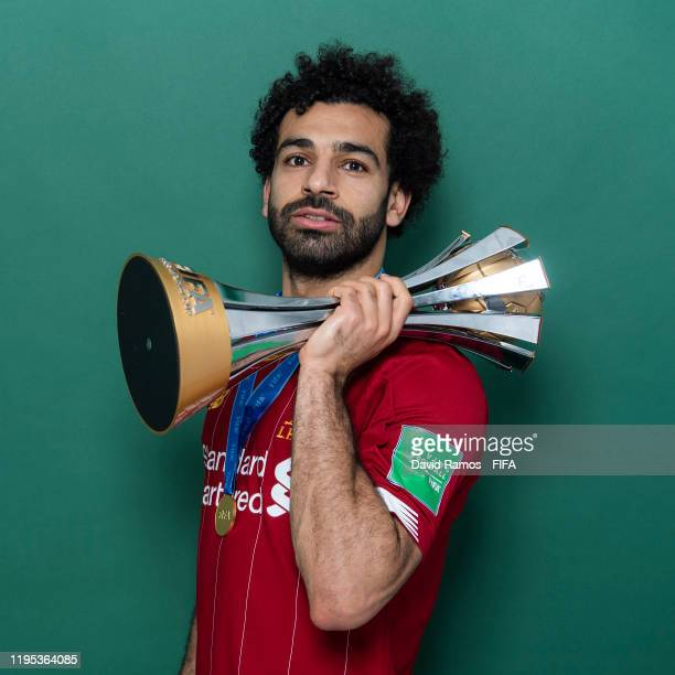 Mohamed Salah of Liverpool poses with the Club World Cup trophy after the FIFA Club World Cup Qatar 2019 Final match between Liverpool and CR...
