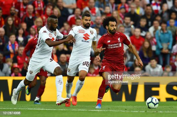 Mohamed Salah of Liverpool powers through during the PreSeason friendly match between Liverpool and Torino at Anfield on August 7 2018 in Liverpool...