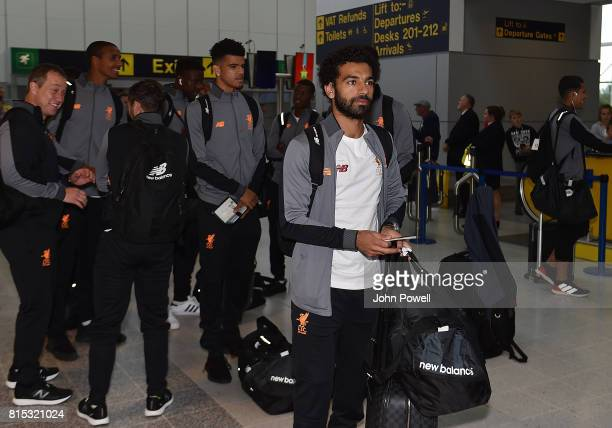 Mohamed Salah of Liverpool prepare their pre season tour at Manchester Airport on July 16 2017 in Liverpool England