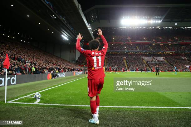 Mohamed Salah of Liverpool prepares to take a corner during the UEFA Champions League group E match between Liverpool FC and RB Salzburg at Anfield...