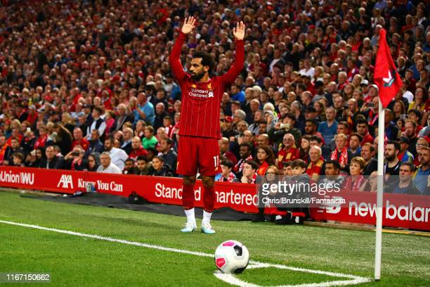 Mohamed Salah of Liverpool prepares to take a corner kick during the Premier League match between Liverpool FC and Norwich City at Anfield on August...