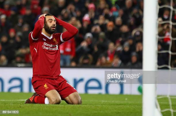 Mohamed Salah of Liverpool reacts after a near miss during the Premier League match between Liverpool and West Bromwich Albion at Anfield on December...