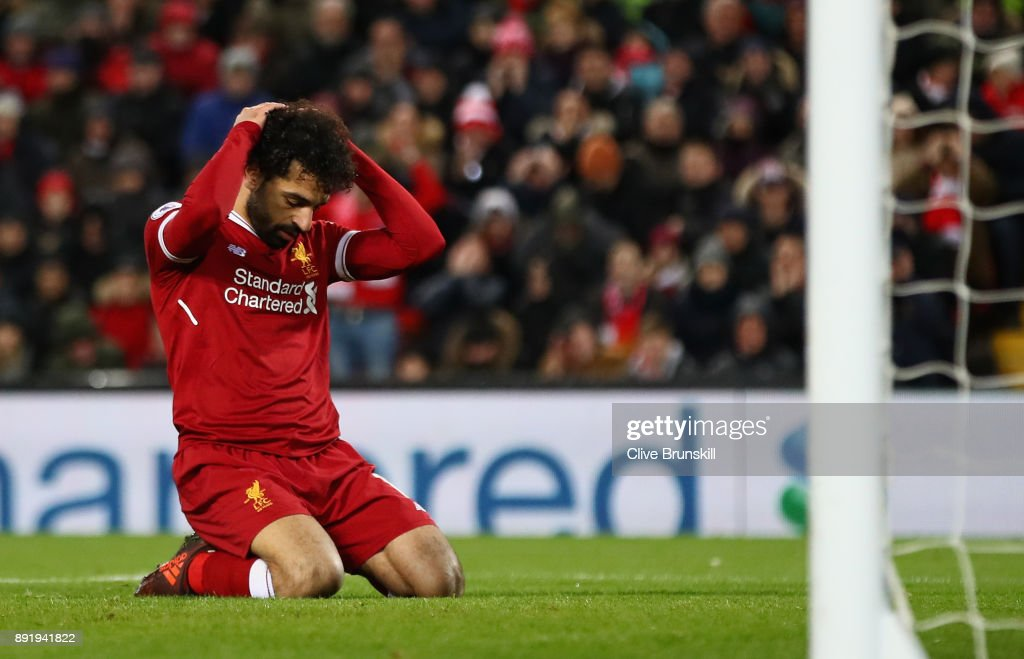 Mohamed Salah of Liverpool reacts after a near miss during the Premier League match between Liverpool and West Bromwich Albion at Anfield on December 13, 2017 in Liverpool, England.