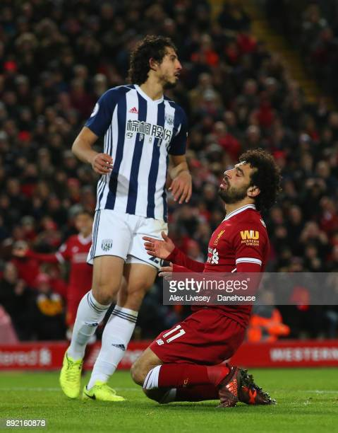 Mohamed Salah of Liverpool reacts after missing a goalscoring chance as Ahmed Hegazi of West Bromwich Albion looks on during the Premier League match...