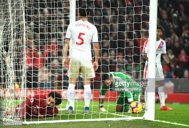 Mohamed Salah of Liverpool reacts after scoring his sides third goal during the Premier League match between Liverpool FC and Crystal Palace at...