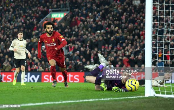Mohamed Salah of Liverpool reacts as his shot goes wide as David De Gea of Manchester United looks on during the Premier League match between...