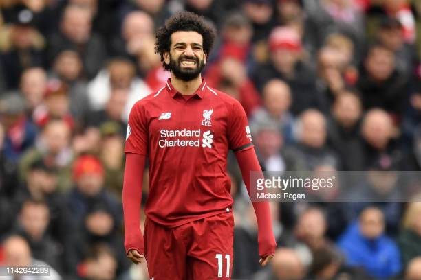 Mohamed Salah of Liverpool reacts during the Premier League match between Liverpool FC and Chelsea FC at Anfield on April 14 2019 in Liverpool United...