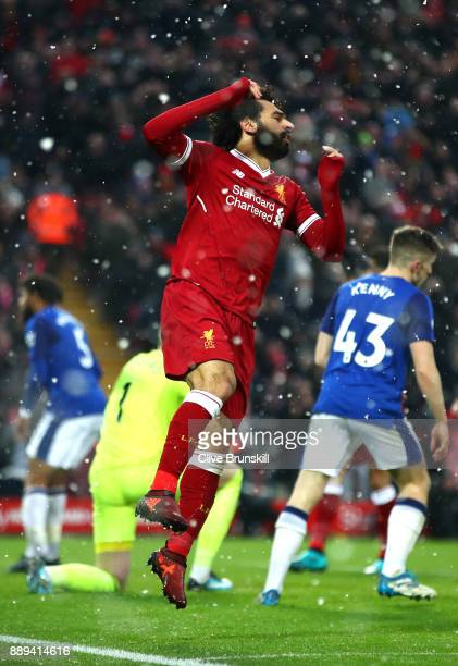 Mohamed Salah of Liverpool reacts to a missed chance during the Premier League match between Liverpool and Everton at Anfield on December 10 2017 in...