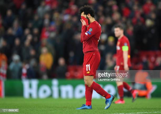 Mohamed Salah of Liverpool reacts to defeat after the UEFA Champions League round of 16 second leg match between Liverpool FC and Atletico Madrid at...