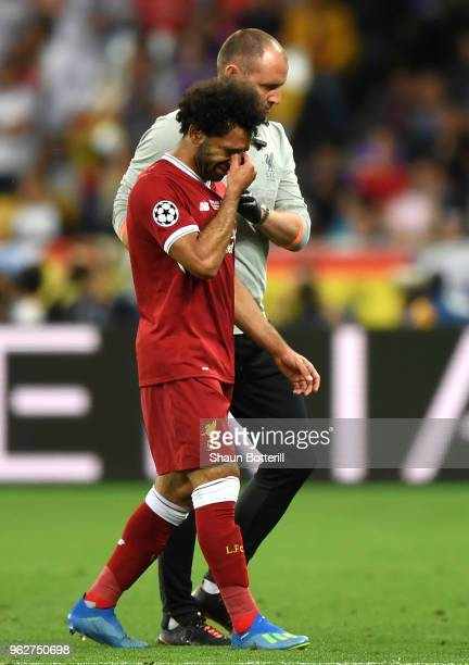 Mohamed Salah of Liverpool reacts whilst leaving the pitch during the UEFA Champions League Final between Real Madrid and Liverpool at NSC...