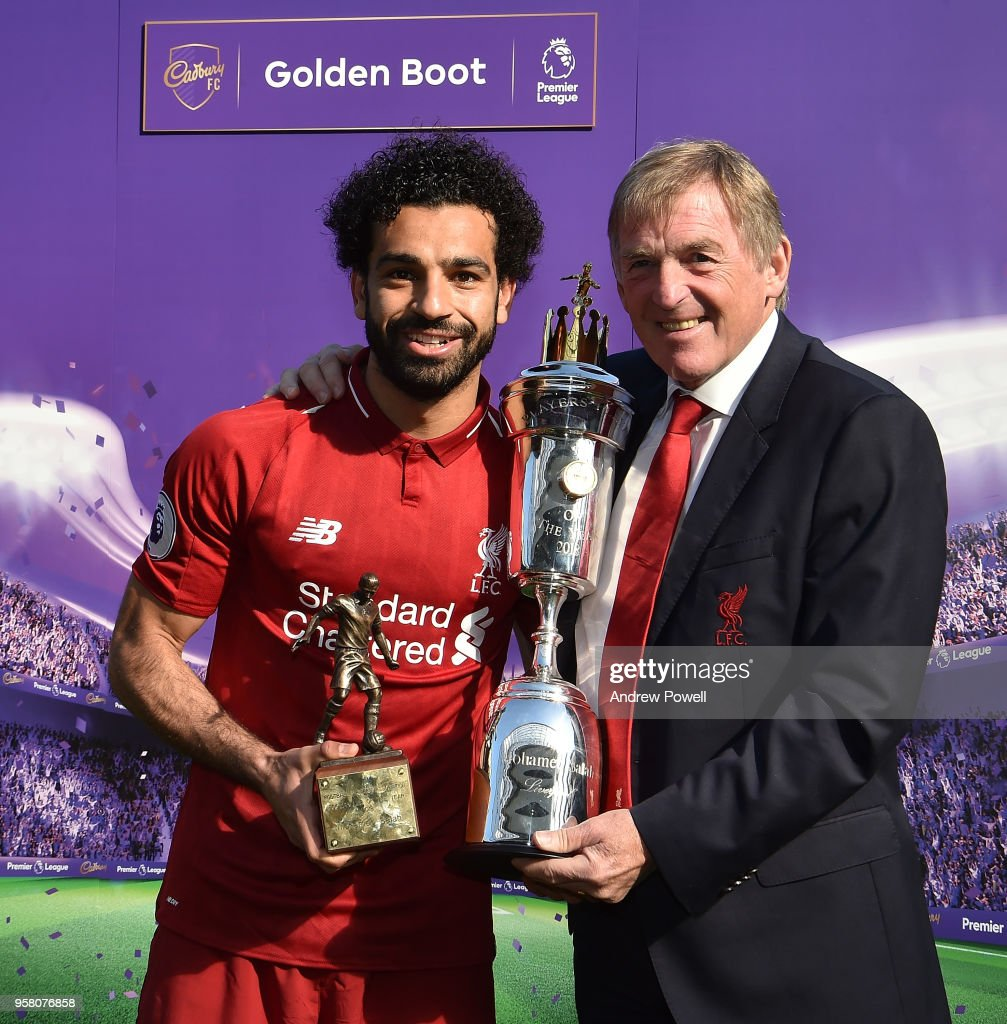 Mohamed Salah of Liverpool Receives The Players Player of the year and the Newspapers writers Player of the year from Kenny Daglish during the Premier League match between Liverpool and Brighton and Hove Albion at Anfield on May 13, 2018 in Liverpool, England.