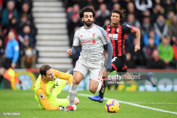 Mohamed Salah of Liverpool rounds Asmir Begovic of Bournemouth to complete his hat trick during the Premier League match between AFC Bournemouth and...