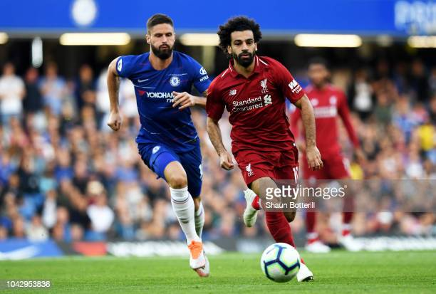 Mohamed Salah of Liverpool runs with the ball away from Olivier Giroud of Chelsea during the Premier League match between Chelsea FC and Liverpool FC...