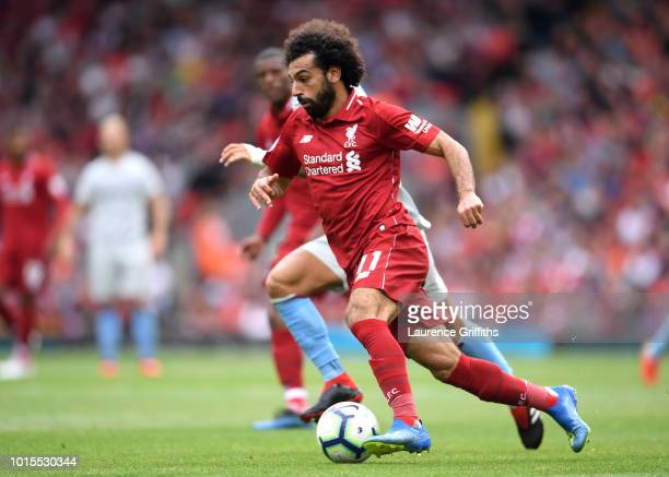 Mohamed Salah of Liverpool runs with the ball during the Premier League match between Liverpool FC and West Ham United at Anfield on August 12 2018...