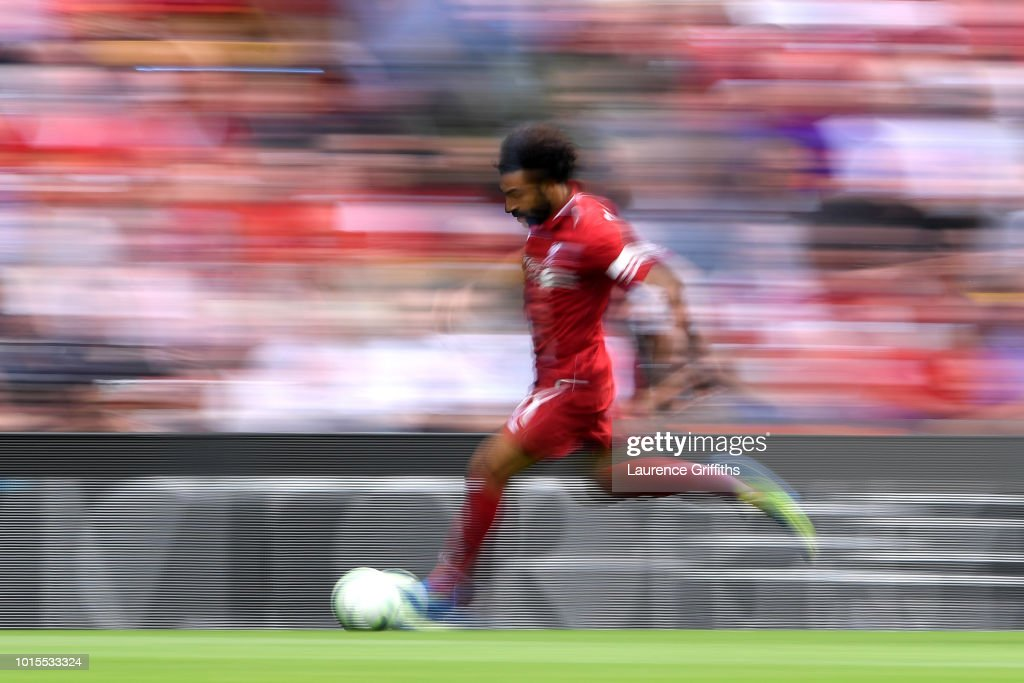 Mohamed Salah of Liverpool runs with the ball during the Premier League match between Liverpool FC and West Ham United at Anfield on August 12, 2018 in Liverpool, United Kingdom.