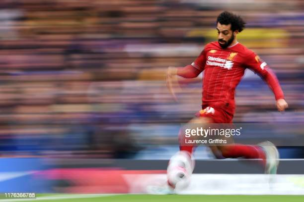 Mohamed Salah of Liverpool runs with the ball during the Premier League match between Chelsea FC and Liverpool FC at Stamford Bridge on September 22...