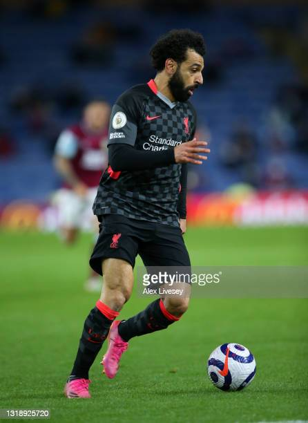 Mohamed Salah of Liverpool runs with the ball during the Premier League match between Burnley and Liverpool at Turf Moor on May 19, 2021 in Burnley,...