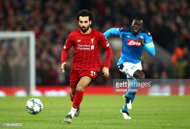 Mohamed Salah of Liverpool runs with the ball during the UEFA Champions League group E match between Liverpool FC and SSC Napoli at Anfield on...