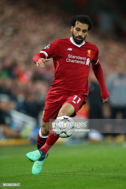 Mohamed Salah of Liverpool runs with the ball during the UEFA Champions League Semi Final First Leg match between Liverpool and AS Roma at Anfield on...