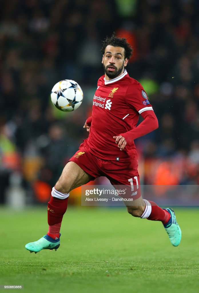 Mohamed Salah of Liverpool runs with the ball during the UEFA Champions League Semi Final First Leg match between Liverpool and A.S. Roma at Anfield on April 24, 2018 in Liverpool, United Kingdom.